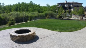 chestermere calgary exposed aggregate concrete contractor firepit chestermere landscaping.jpg